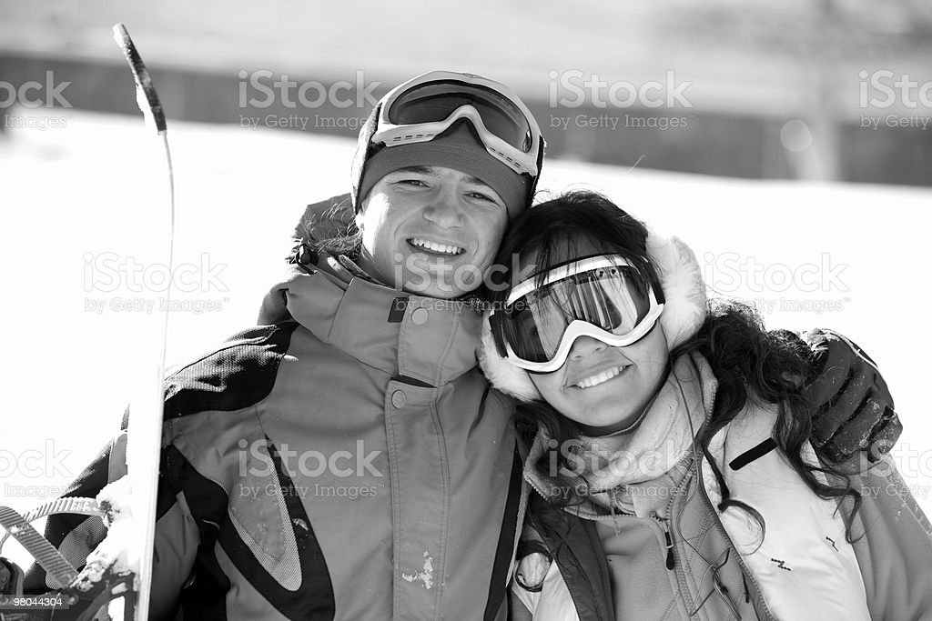 Lucky couple  snowboarders  in a mountain royalty-free stock photo