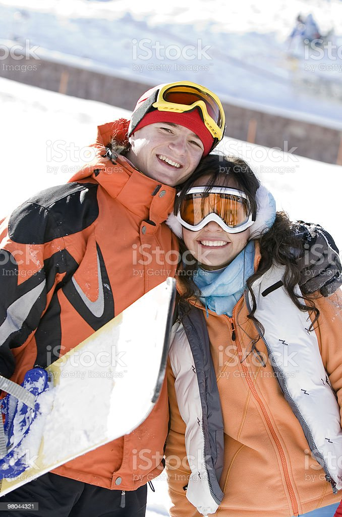 Lucky couple  snowboarders  in a mountain valley royalty-free stock photo