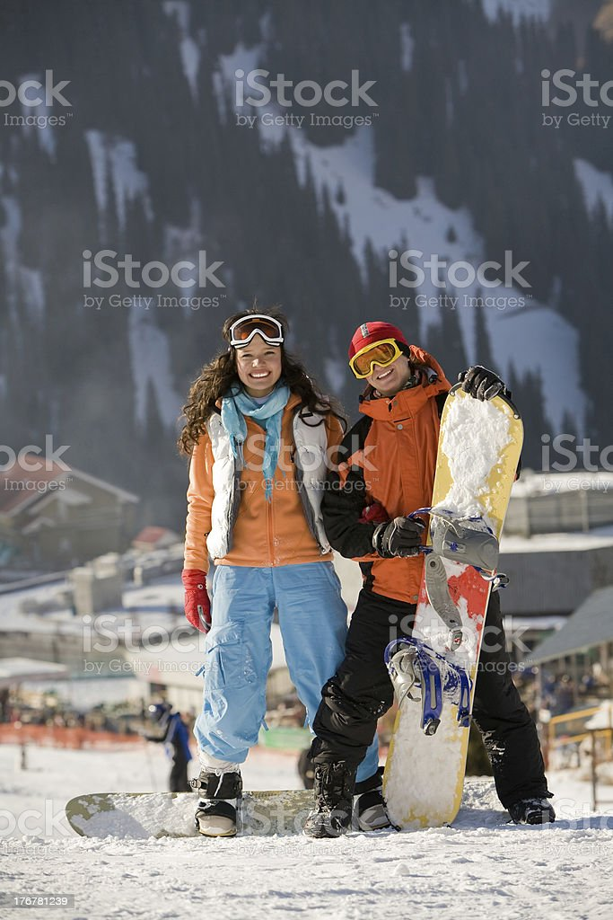 Lucky couple  snowboarders  team in a mountain valley stock photo