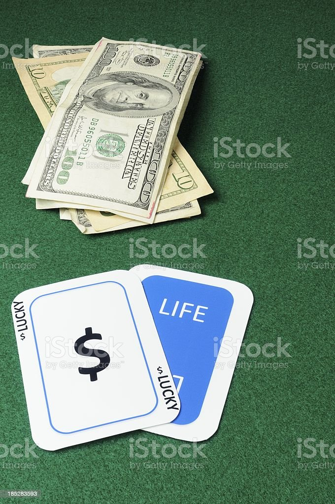 Lucky in life cards with cash royalty-free stock photo