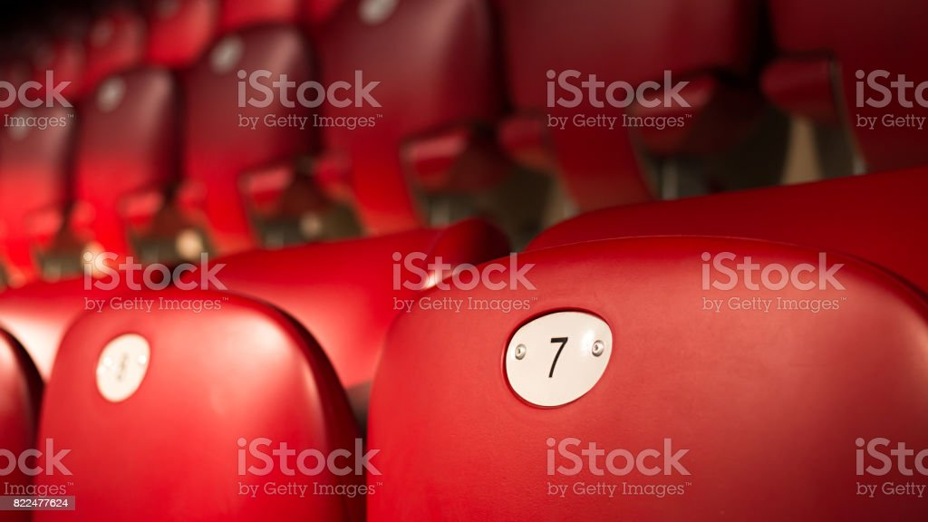 Lucky Number Seven On Empty Red Chair stock photo