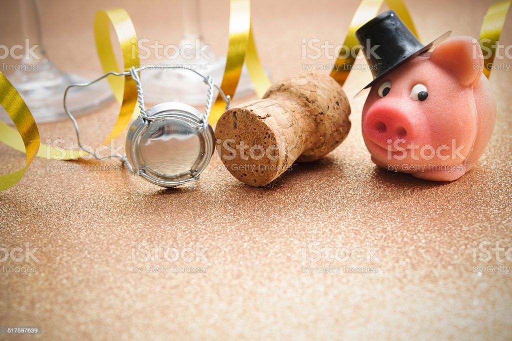 Lucky piggy and cork from champagne bottle stock photo