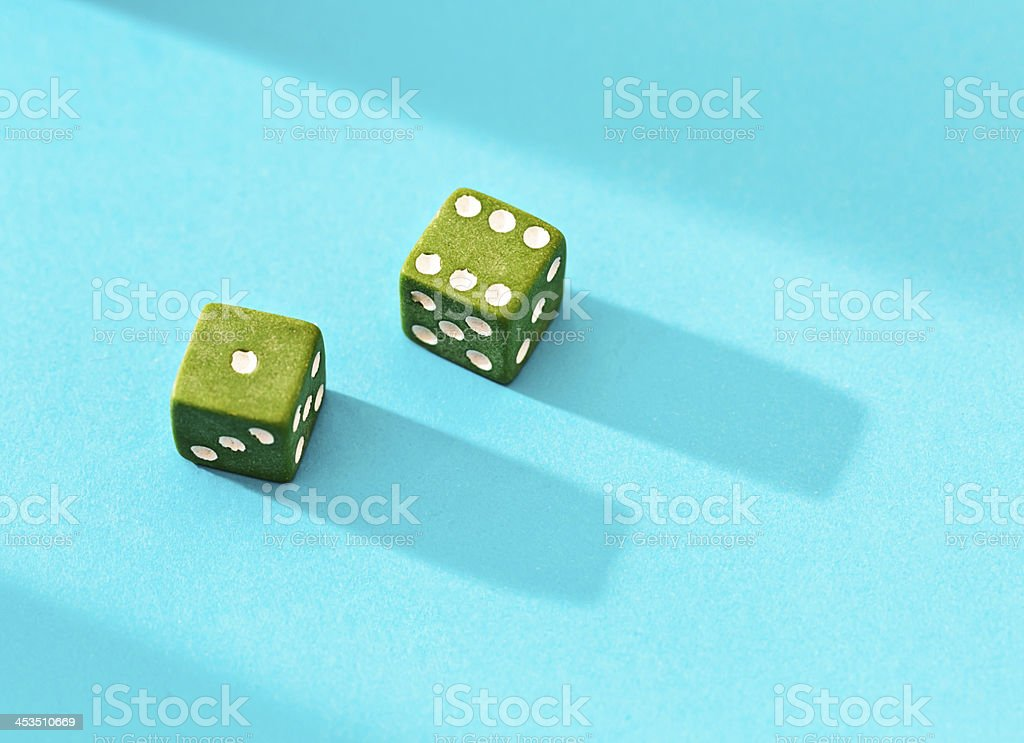 Lucky throw! Score of 7 on green dice royalty-free stock photo