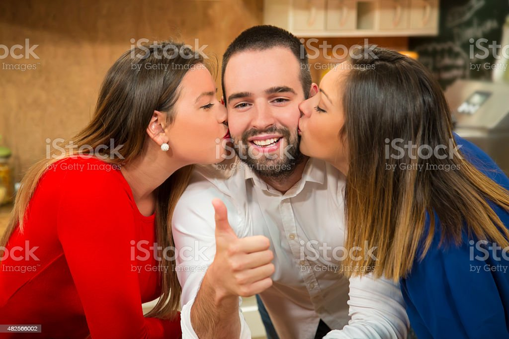 Lucky young man showing thumb up. stock photo