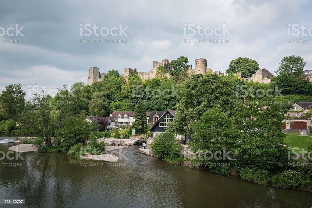 Ludlow castle and riverside Ludlow, UK - 19 June, 2014: Ludlow Castle and riverside. Ancient Stock Photo