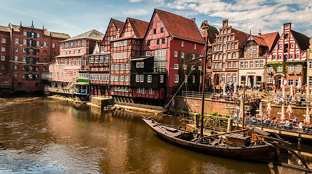 Lüneburg LAneburg, Germany - April 30th, 2012: city center during a sunny day of spring. LAneburg is one one of the most conserved cities in the north of Germany, here an example of the old medieval-style constructions. lüneburg stock pictures, royalty-free photos & images