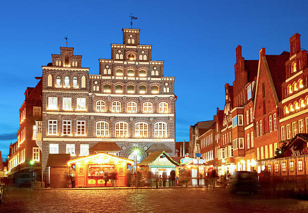 Lueneburg, Germany (close to Hamburg). Old, famous chamber of industry and commerce at night with christmass-market. lüneburg stock pictures, royalty-free photos & images