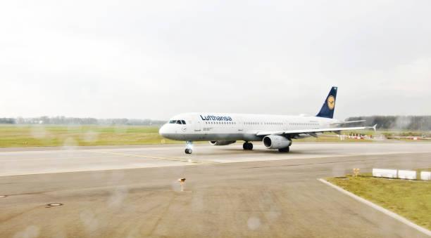 A Lufthansa airplane on the tarmac ready for take-off from Munich International Airport (aka Flughafen München). IATA: MUC, ICAO: EDDM stock photo