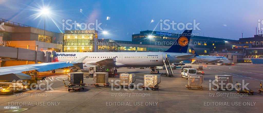 Lufthansa Flight at the gate in early morning stock photo