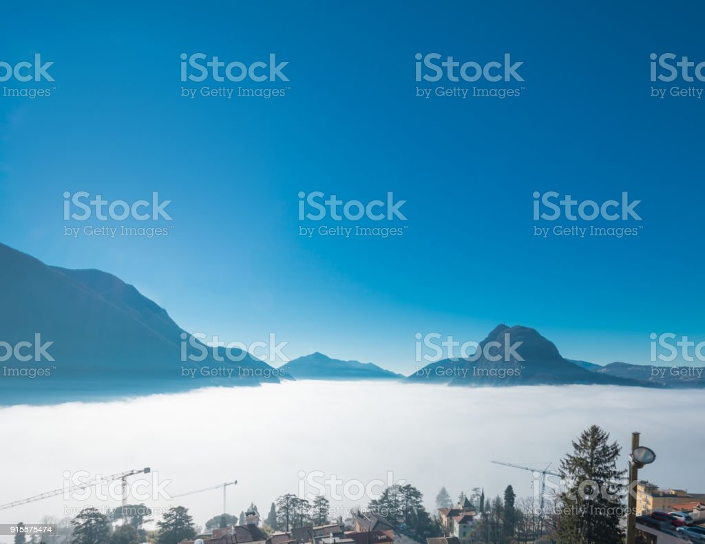 Lugano landscape with atmospheric phenomenon stock photo