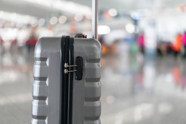 luggage and belongings in airport terminal - oggetti personali foto e immagini stock