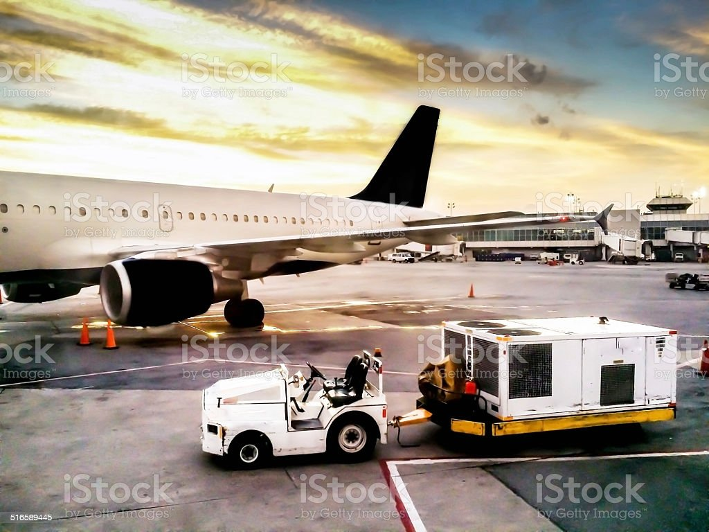 Luggage Car Near Airplane stock photo