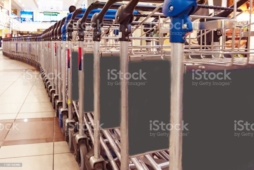 luggage carts in Santiago airport terminal, Chile - Royalty-free Advertisement Stock Photo
