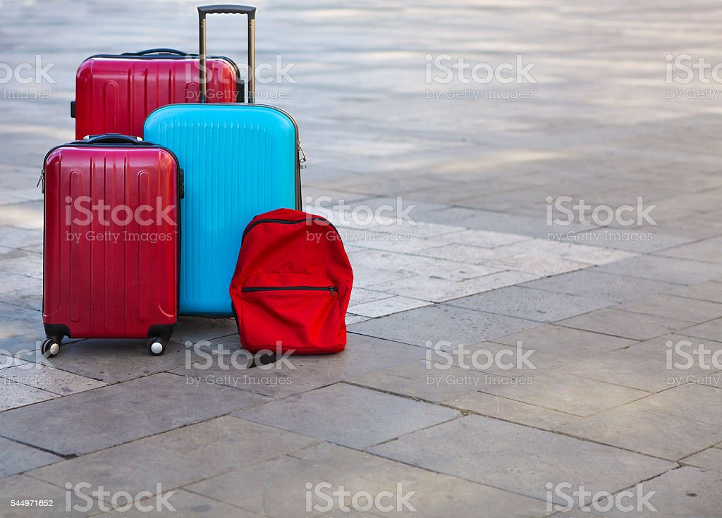 Luggage consisting of three large suitcases and travel backpack - Photo