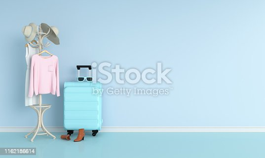 istock luggage in blue room for mockup, 3D rendering 1162186614
