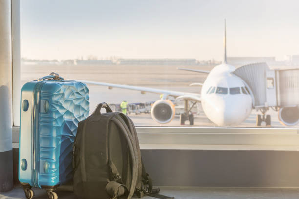 Luggage in front of an airplane at the airport air travel carry on luggage stock pictures, royalty-free photos & images