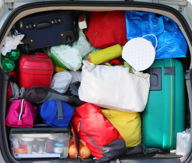 luggage in the family car before the long holiday trip lot of luggage in the family car before the long holiday trip full stock pictures, royalty-free photos & images