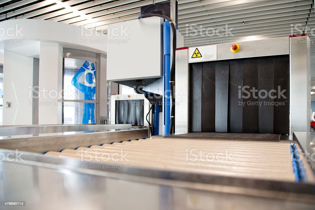 Luggage inspection system and body scanner stock photo