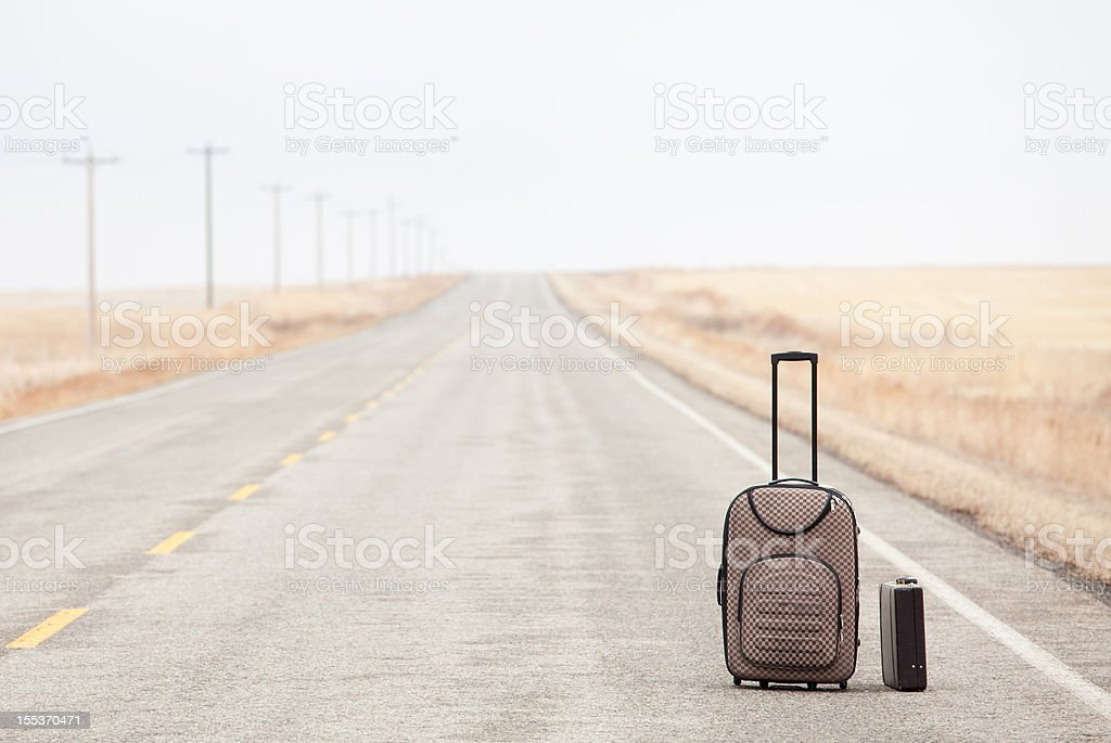 Luggage on a Rural Road royalty-free stock photo