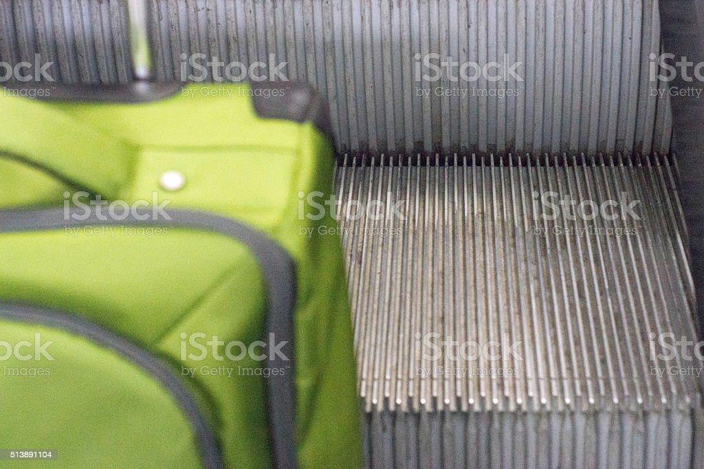 Luggage on escalator stock photo