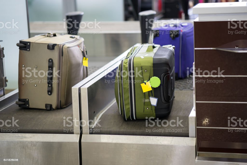 Luggage on weight at check-in counter at airport stock photo