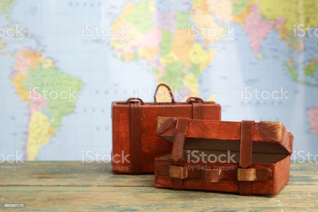 Luggage on world map background. Travel concept stock photo