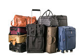A large assortment of luggage on white background.