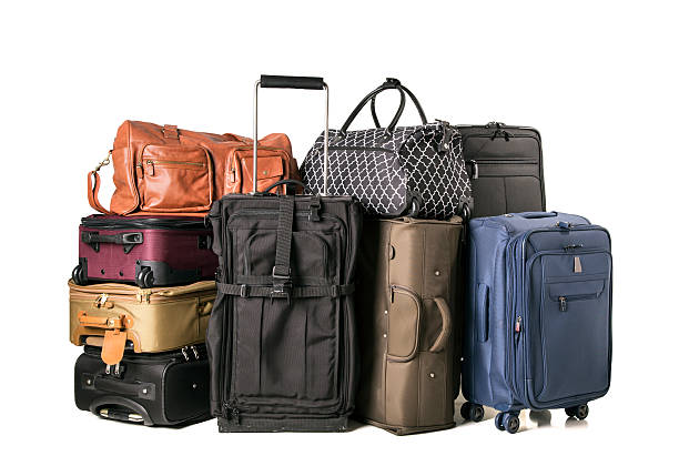 Luggage A large assortment of luggage on white background. luggage stock pictures, royalty-free photos & images
