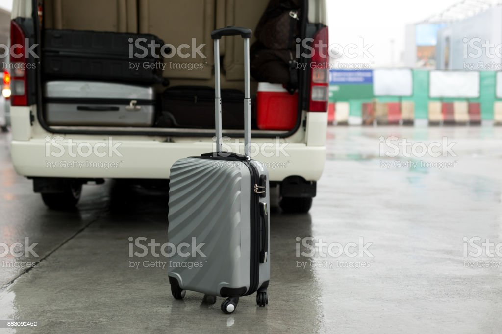 Luggage stand on the road and arrange on the van for a trip stock photo