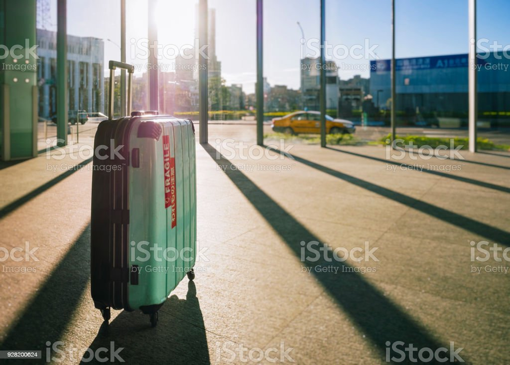 Luggage Suitcase Airport Arrival gate building Travel concept stock photo