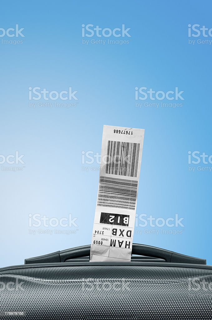 Luggage tag with suitcase Luggage tag on suitcase handle and blue sky Bag Stock Photo