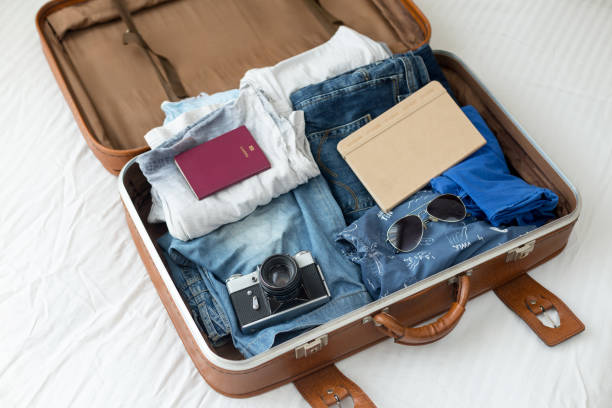 luggage with clothes, other items - bagaglio foto e immagini stock