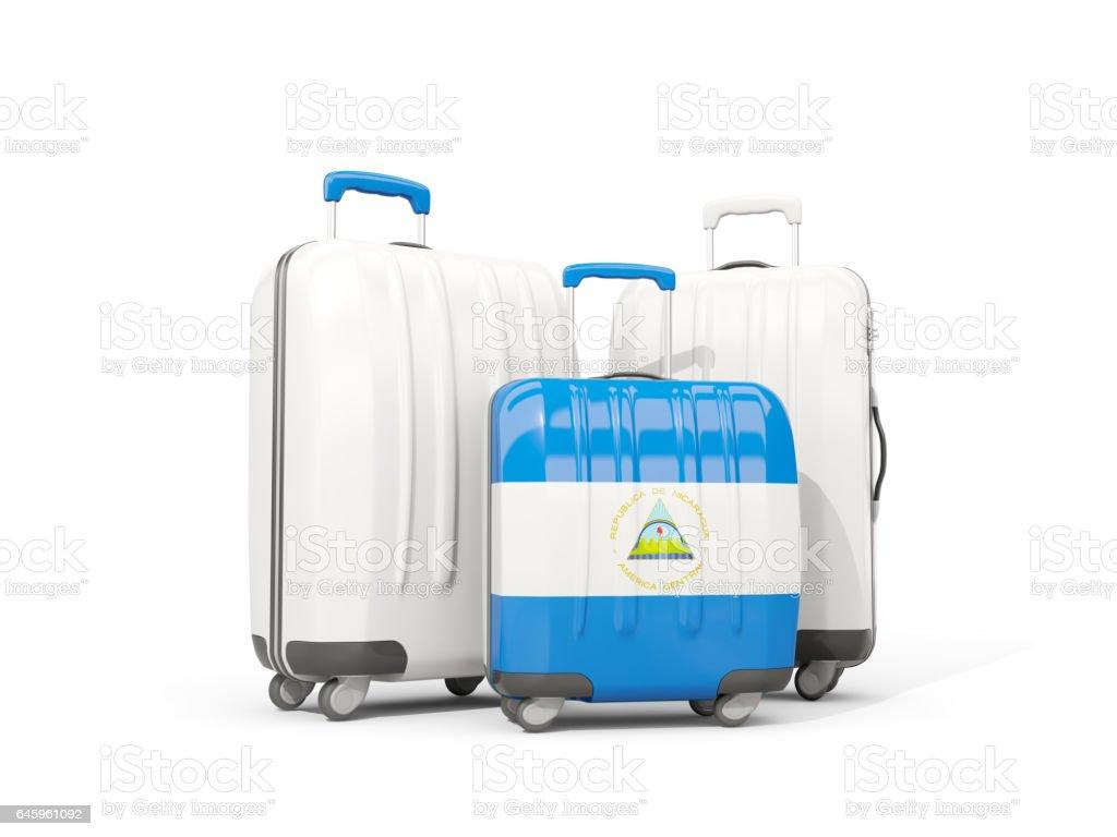 Equipaje con la bandera de nicaragua. Tres bolsos aislados en blanco - foto de stock