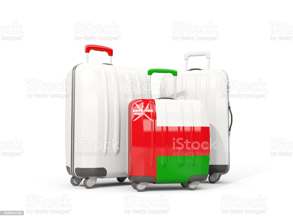 Luggage with flag of oman. Three bags isolated on white stock photo