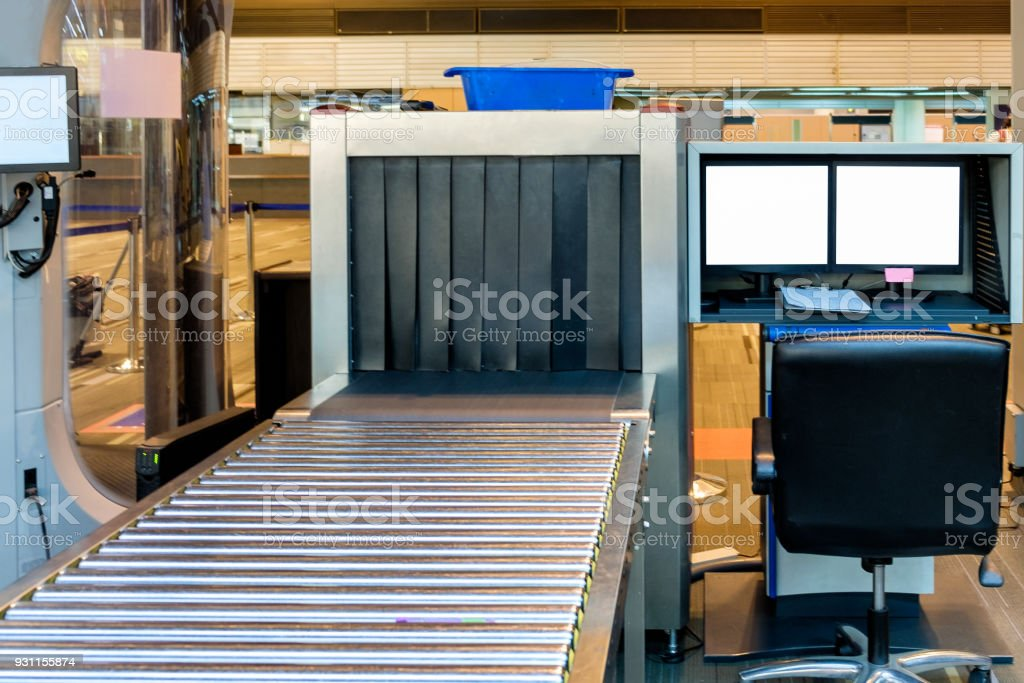 Luggage Xray Scanner In Airport Stock Photo - Download Image