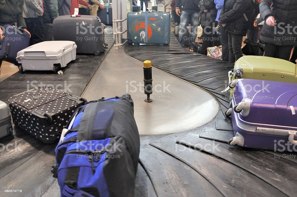 Luggages moving on baggage belt stock photo