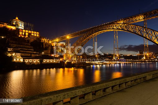 D. Luis I bridge illuminated over Douro river at night. City of Porto