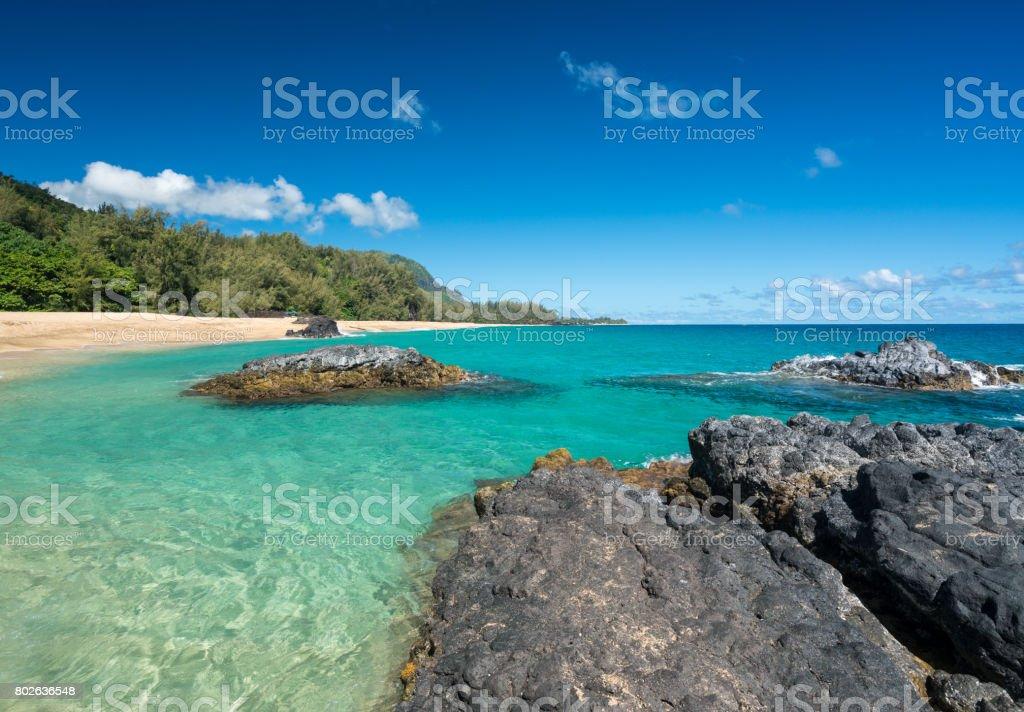 Lumahai Beach Kauai  with rocks stock photo