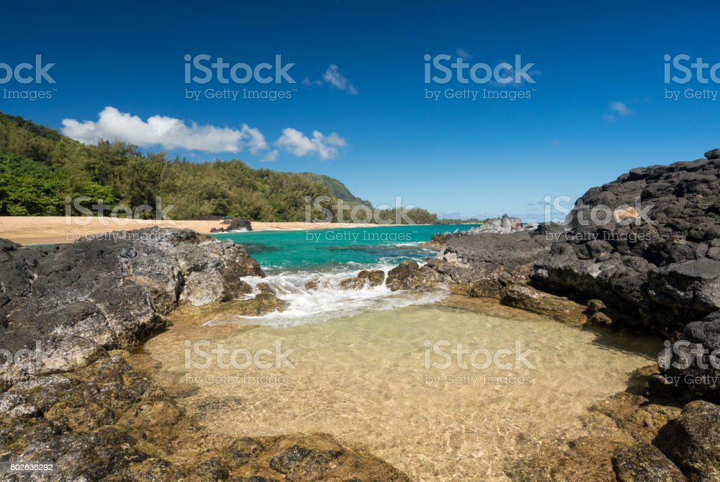 Lumahai Beach Kauai with waves flowing into pool stock photo