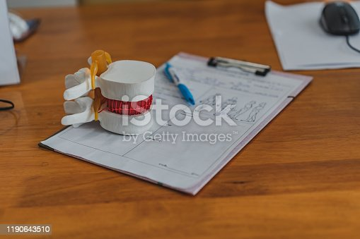 609830806 istock photo Lumbar spine model on table in Physiotherapy clinic11 1190643510