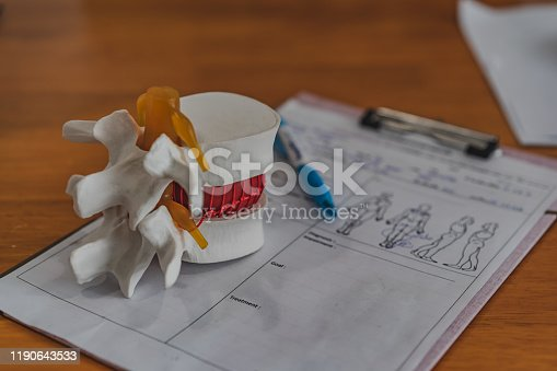 609830806 istock photo Lumbar spine model on table in Physiotherapy clinic11 1190643533