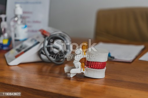 609830806 istock photo Lumbar spine model on table in Physiotherapy clinic11 1190643622