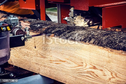 Lumber industry - Cutting a log at sawmill