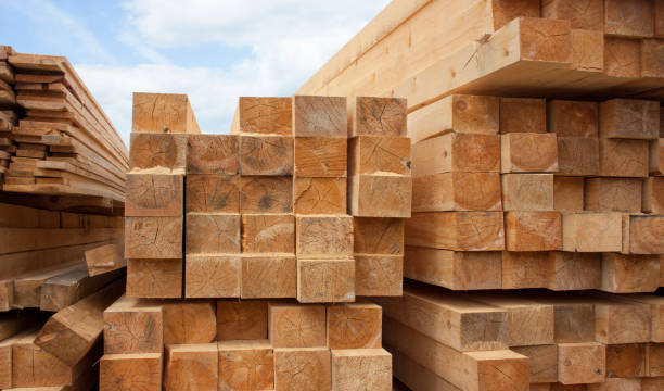 Lumber warehouse. Wood planks and timber stacked in stacks outdoors Lumber warehouse. Wood planks and timber stacked in stacks outdoors timber stock pictures, royalty-free photos & images