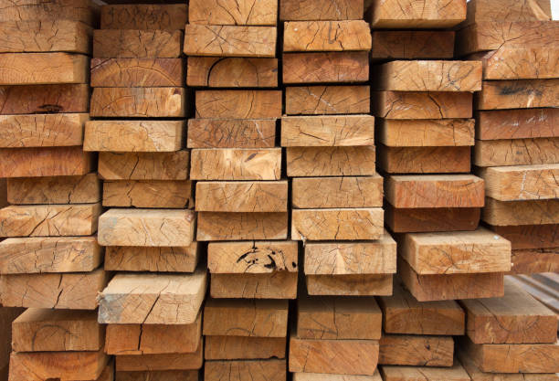 Lumber warehouse. Wooden boards are stacked. Wood texture, background stock photo