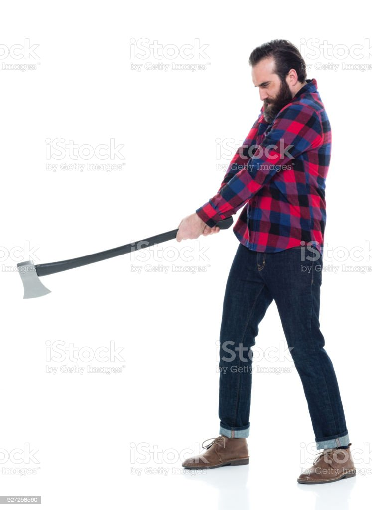 lumberjack-with-axe-swinging-axe-picture-id927258560