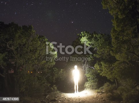 istock luminosity figure at night 482674393