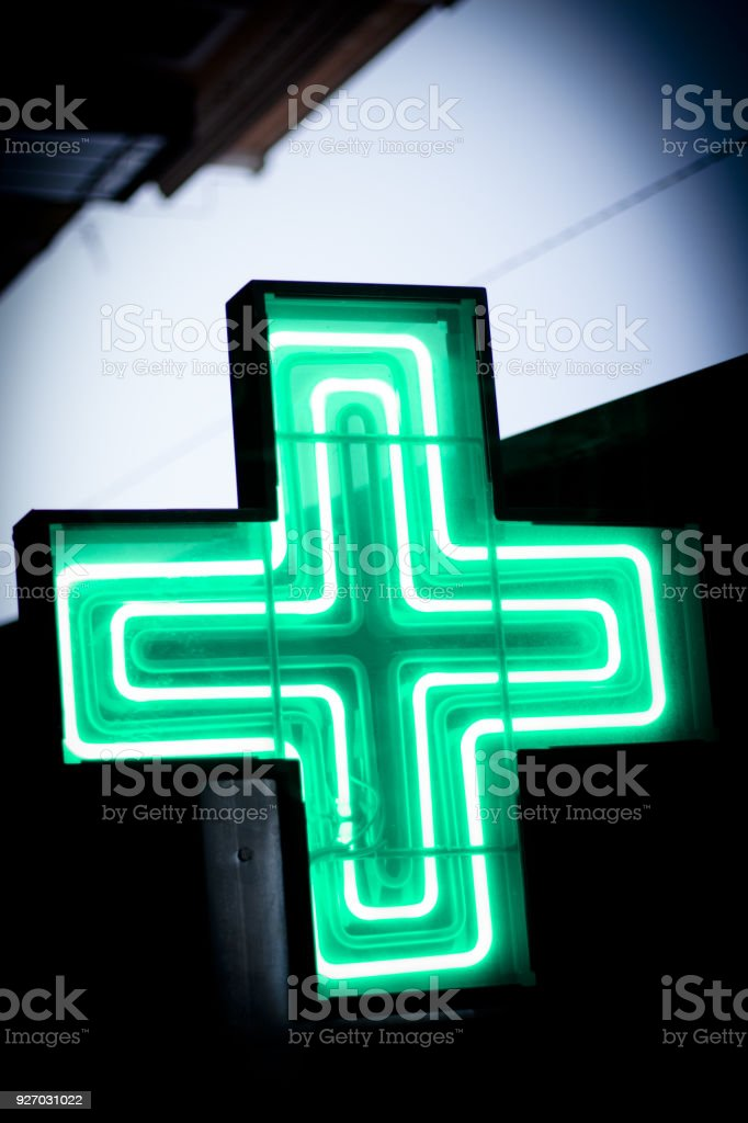 Luminous green cross. No people stock photo