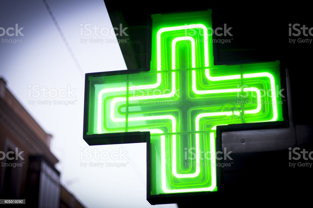 Luminous green cross stock photo