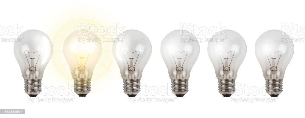 luminous light bulb - new idea in a row stock photo